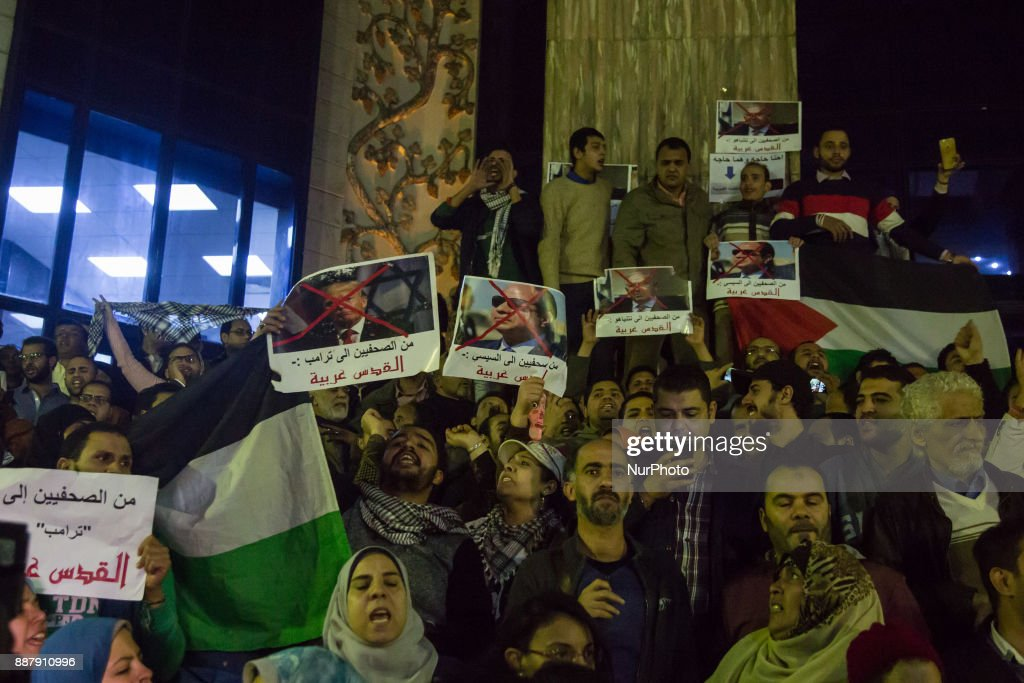 Egyptian protesters hold a portrait of Egyptian President Abdel Fattah al-Sisi and US president Donald Trump and Israeli Prime Minister Benjamin Netanyahu during a demonstration against the US president's recognition of Jerusalem as Israel's capital, on December 7, 2017, outside the Syndicate of Journalists Cairo's downtown district.