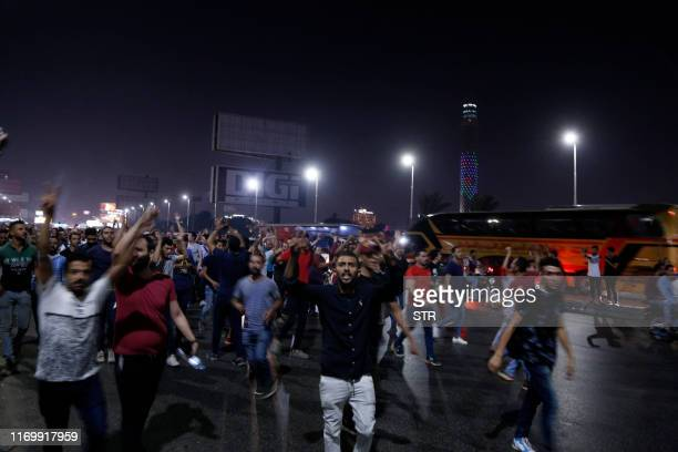 Egyptian protesters shout slogans as they take part in a protest calling for the removal of President Abdel Fattah alSisi in Cairo's downtown on...
