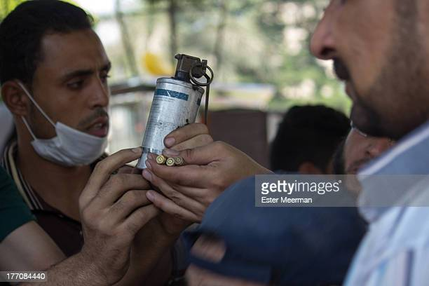 CONTENT] Egyptian protesters showing live ammunition and an empty tear gas canister supposedly used on them by riot police the bullets they are...