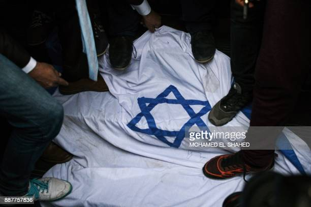 Egyptian protesters step on an Israeli flag during a demonstration against the US president's recognition of Jerusalem as Israel's capital on...