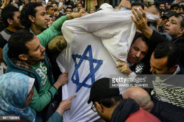 Egyptian protesters tear apart an Israeli flag during a demonstration against the US president's recognition of Jerusalem as Israel's capital on...
