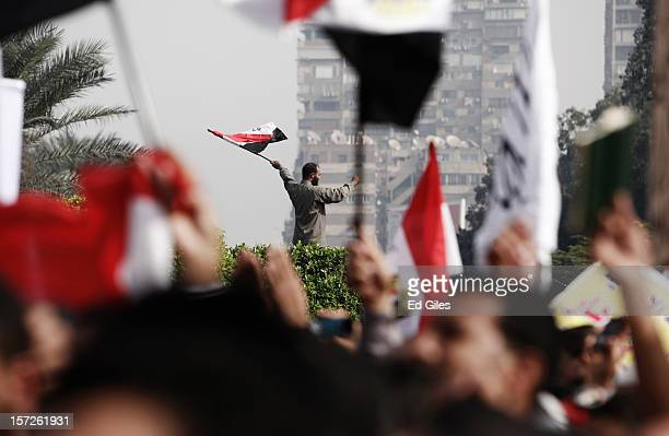 Egyptian protesters wave the Egyptian flag during a demonstration supporting Egyptian President Mohammed Morsi in front of Cairo University December...