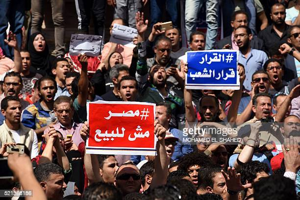 Egyptian protesters with placards shout slogans during a demonstration against a controversial deal to hand two islands in the Red Sea to Saudi...