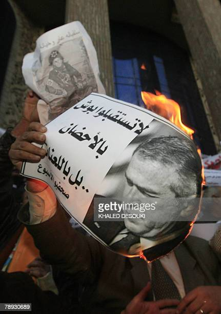Egyptian protestors burn portraits of US President George W Bush during a demonstration against his visit to the region outside the journalists union...