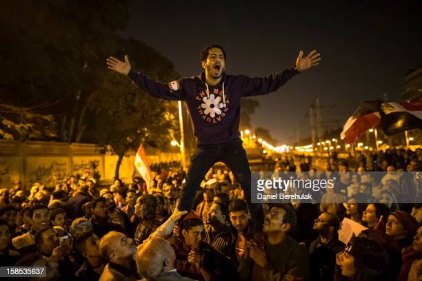 Egyptian protestors opposing President Mohammed Morsi chant slogans during a demonstration at the Presidential Palace on December 18, 2012 in Cairo,...