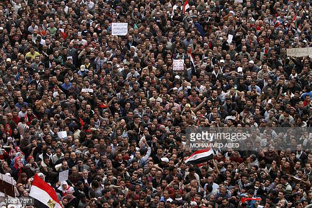 Egyptian protestors take part in a demonstration on February 1, 2011 at Cairo's Tahrir Square as massive tides of protesters flooded Cairo for the...