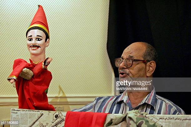 EGYPTCULTURETHEATREARAGOZ Egyptian puppeteer Mustafa Othman known as Am Saber performs with his Aragoz puppet at the Egyptian National Theater in...