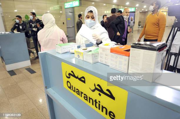 Egyptian Quarantine Authority employees prepare to scan body temperature for incoming travellers at Cairo International Airport on February 1 amidst...