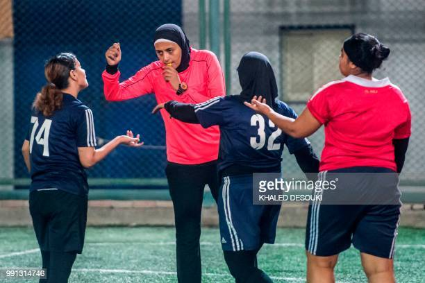 Egyptian referee Hanan Hassan blows a whistle while gesturing during a women football match in Cairo on June 3 2018 In April the Egyptian Football...