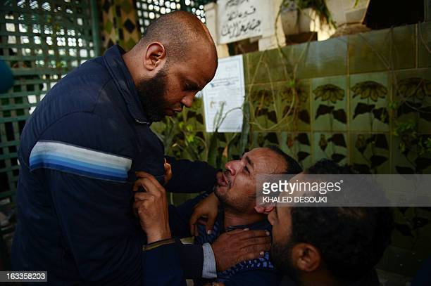 Egyptian relatives and friends mourn over the death of Abdelhalim Mehana who was killed during clashes with riot police on March 4 during his funeral...
