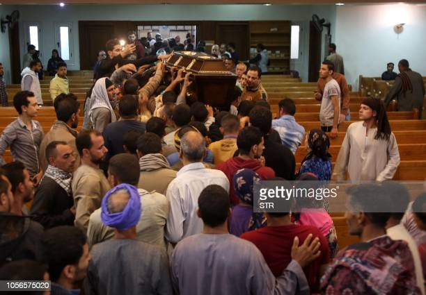 Egyptian relatives and friends of Christian Assad Labib, 35 year old, react during his funeral at the Anglican Church in Sawaada village near Minya...