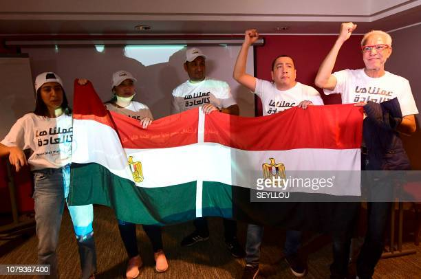 Egyptian representatives wave their national flag as they celebrate the Confederation of African Football executive committee's decision to choose...