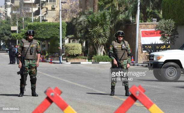 Egyptian Republican Guardsmen stand guard outside a polling station in the capital Cairo's eastern neighbourhood of Heliopolis on March 26 on the...