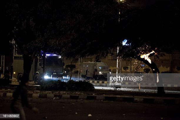 Egyptian riot police armoured vehicles approach protesters during violent protests by the Presidential Palace in Heliopolis February 11 2013 in Cairo...