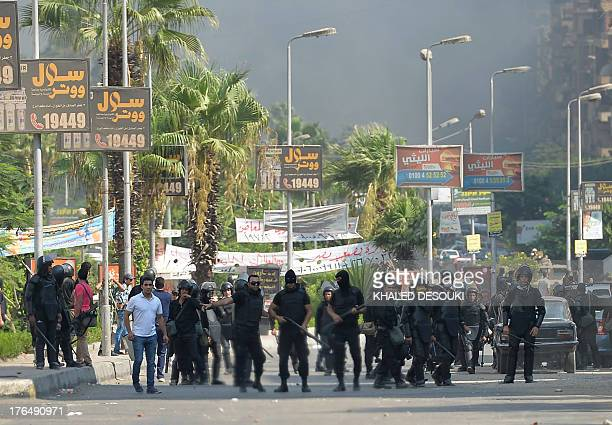 Egyptian riot police disperse supporters of Egypt's ousted president Mohamed Morsi and members of the Muslim Brotherhood as security forces crackdown...