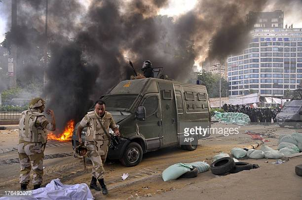 Egyptian riot police forces moved in on a huge protest camp set up by supporters of Egypt's ousted president Mohamed Morsi in Cairo's Al-Nahda square...