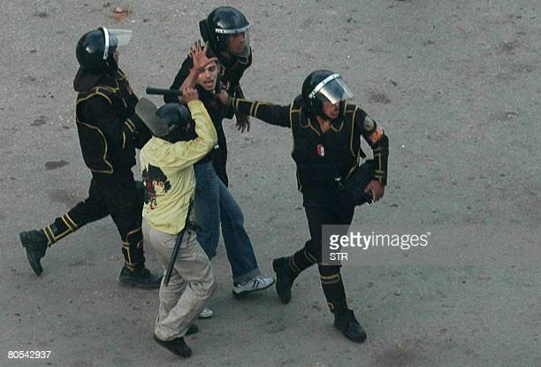 Egyptian riot policemen detain a demonstrator in the town of Mahala 140 kms north of Cairo on April 6 2008 Plans for a general strike in Egypt...