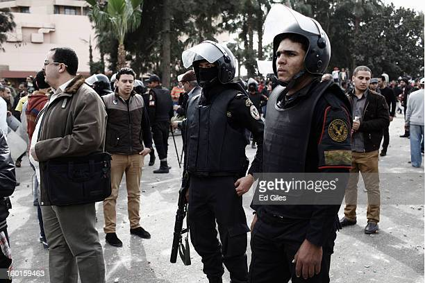 Egyptian riot policemen stand amonst Egyptian civilians during a demonstration in Tahrir Square on January 27 2013 in Cairo Egypt Violent protests...