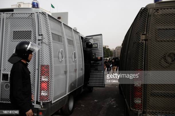 Egyptian riot policemen stand by an armoured vehicle during a demonstration in Tahrir Square on January 27 2013 in Cairo Egypt Violent protests...