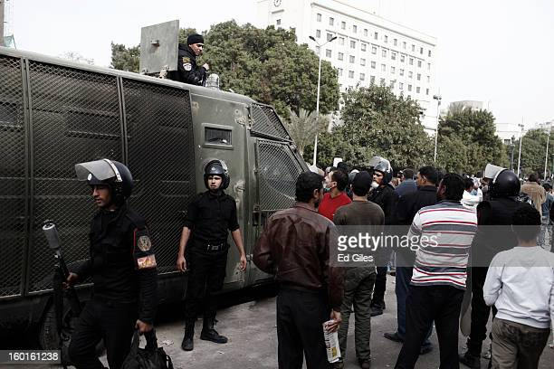 Egyptian riot policemen stand by an armoured vehicle parked amonst Egyptian civilians during a demonstration in Tahrir Square on January 27 2013 in...