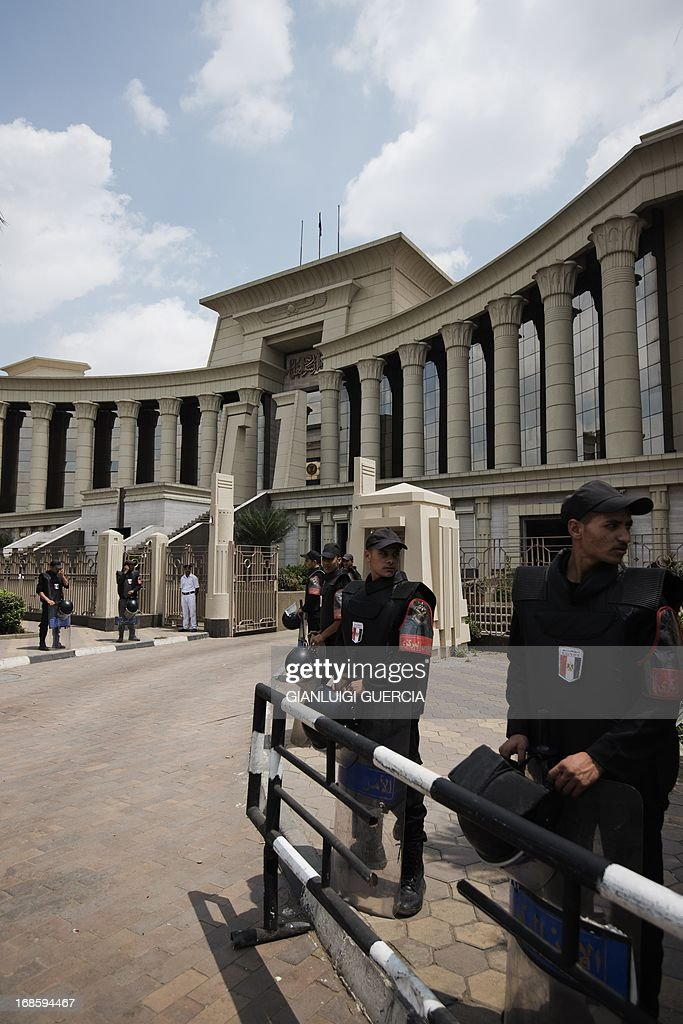Egyptian riot policemen stand outside the Supreme Constitutional Court (SCC) on May 12, 2013 in Cairo, Egypt. The SCC is expected to hear an appeal against the constitutionality of the Shura Council, the upper house of parliament.