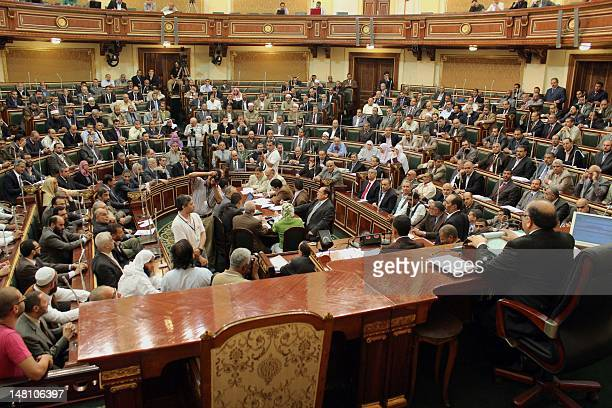 Egyptian Saad alKattatni speaker of the parliament attends with members the first session of the Egyptian parliament in Cairo on July 10 after...