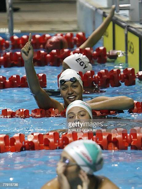 Egyptian Salma Zenhum gestures with a smile after winning the gold medal in the 50m Breast stroke during the 11th Pan Arab Games in Cairo, 14...