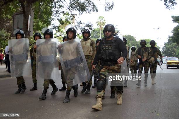 Egyptian security arrive at a rally by supporters of the Muslim Brotherhood and of ousted president Mohamed Morsi in the port city of Alexandria on...