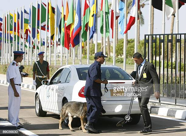 Egyptian security check a delegation vehicule at the entrance to the congress center where the 15th summit of the NonAligned Movement is convening in...