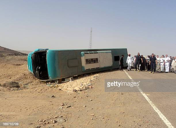 Egyptian security forces and emergency personnel gather at the site of a road accident in Egypt's Sinai Peninsula on May 31 2013 which left four...