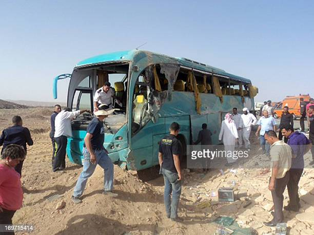Egyptian security forces and emergency personnel inspect the bus at the site of a road accident in Egypt's Sinai Peninsula on May 31 2013 which left...