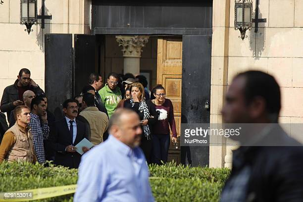 Egyptian security forces and members of the clergy inspect the scene of a bomb explosion at the Saint Peter and Saint Paul Coptic Orthodox Church on...