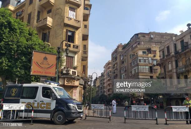 Egyptian security forces block the road leading to Cairo's Tahrir square on September 27, 2019. - Egypt braced today for a second weekend of...