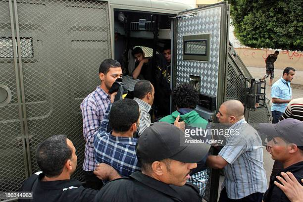Egyptian security forces detain students who stage anti-coup protests at the Al-Azhar University's administrative building on October 30, 2013 in...