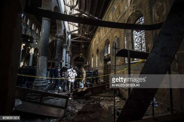 TOPSHOT Egyptian security forces inspect the scene of a bomb explosion at the Saint Peter and Saint Paul Coptic Orthodox Church on December 11 in...