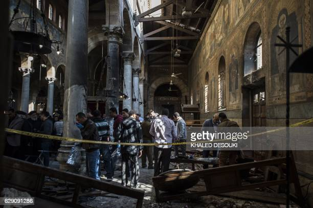 Egyptian security forces inspect the scene of a bomb explosion inside the Saint Peter and Saint Paul Coptic Orthodox Church on December 11 in Cairo's...