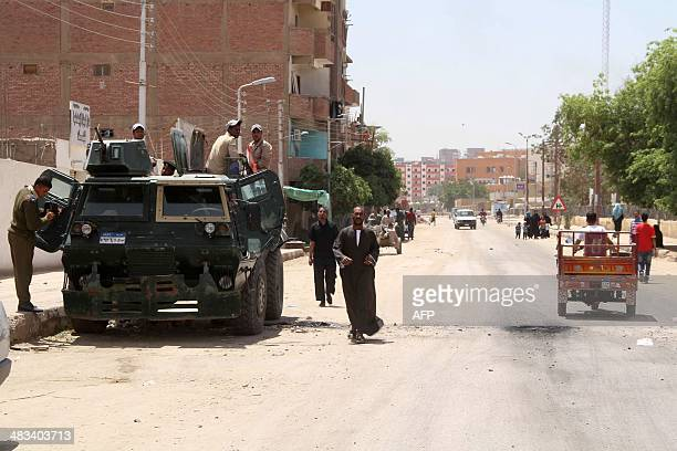 Egyptian security forces keep watch in the southern Egyptian city of Aswan on April 6 2014 following tribal clashes which killed at least 23 people...