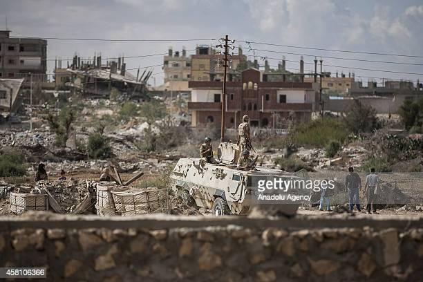 Egyptian security forces launch an operation after they hit some houses in Rafah near the border with southern Gaza Strip October 30 2014 Egypt began...