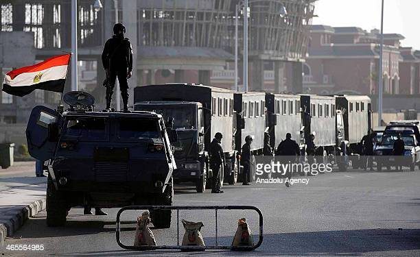 Egyptian security forces stand guard around the Cairo's Police Academy during Egyptian president Mohamed Morsi and other defendants arrived at...