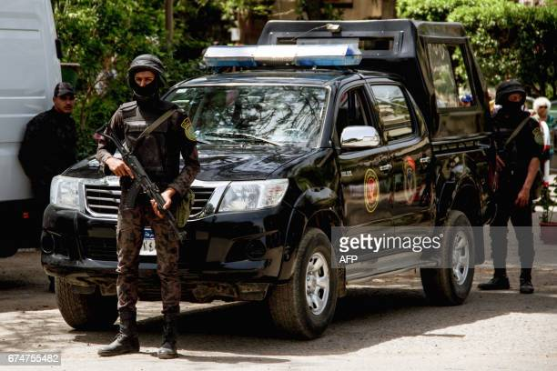 Egyptian security forces stand guard around the Coptic Catholic College of Theology and Humanities in the southern Cairo suburb of Maadi on April 29...