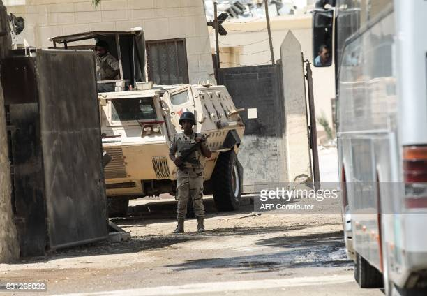 Egyptian security forces stand guard at the border as Palestinian Muslim pilgrims arrive at the Rafah crossing between Egypt and the southern Gaza...