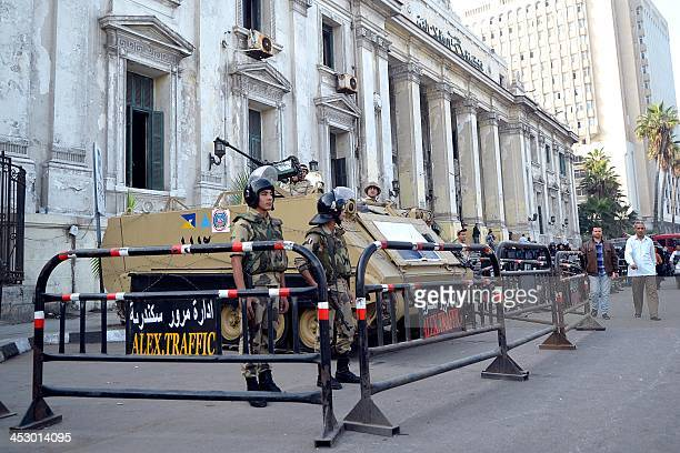 Egyptian security forces stand guard on December 2 2013 outside the criminal court in Egypt's northern coastal city of Alexandria where the second...