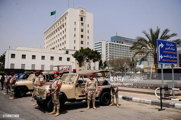 Egyptian security forces stand guard outside the Arab League headquarters in Cairo on April 22 as Army chiefs from Arab League nations meet in the...