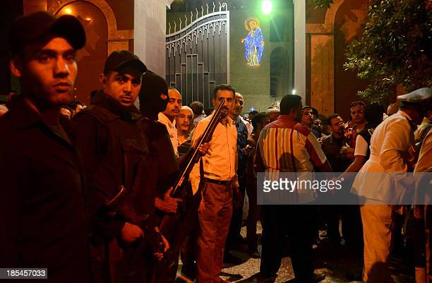 Egyptian security forces stand guard outside the entrance of the Virgin Mary Coptic Christian church in Cairo after gunmen on a motorbike shot dead...
