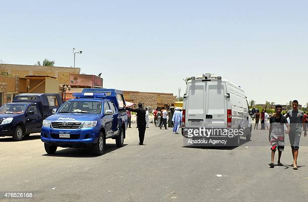 Egyptian security forces take security measures at the site of a suicide car bomb attack near the ancient Karnak Temple in Egypts southern city of...