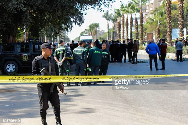 Egyptian security officials inspect the site of a bomb blast in Giza Egypt 09 December 2016 At least six police officers were killed and three others...