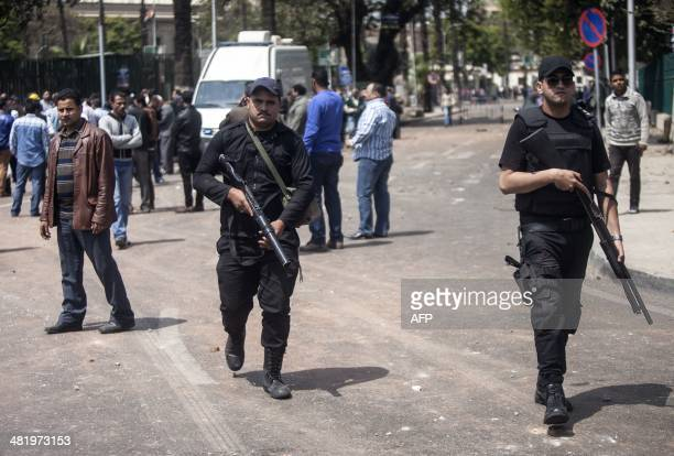 Egyptian security patrol the area after twin bombs struck police posts near Cairo University in the centre of Egypt's capital on April 2 which was...