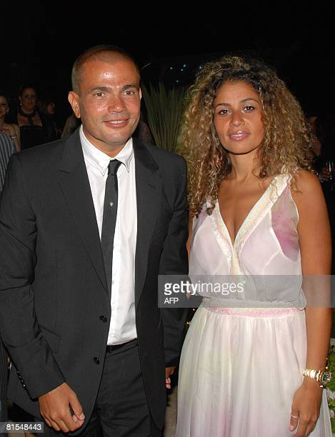 Egyptian singer Amr Diab and his wife Zeina attend the wedding party of Sherif Ramzi the son of Egyptian producer Mohammed Ramzi and Mona Fahmi the...
