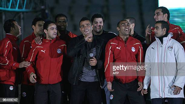 Egyptian singer Amr Diab is joined by players of the Egyptian national football team recently crowned champions of the African Cup of Nations during...