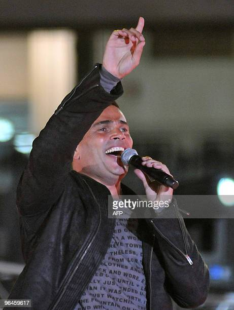 Egyptian singer Amr Diab performs during a benefit concert in Cairo for the victims of recent floods in southern Egypt and the Sinai late on February...